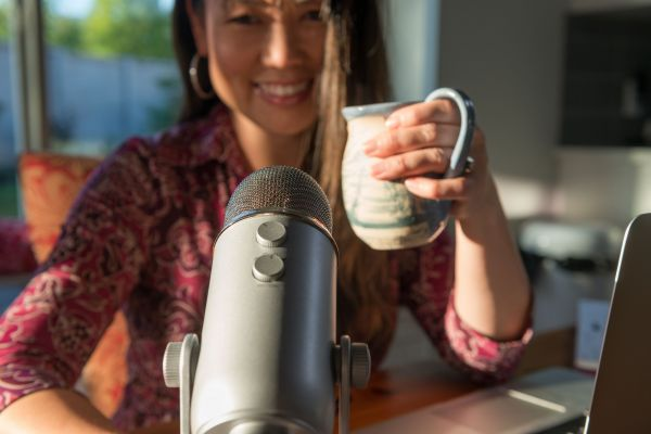 Podcaster with Microphone